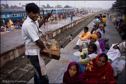 Sitamarhi peanut vendor India train top roof Photograph  Adrian Freeman